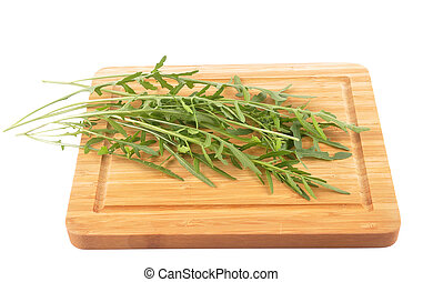Roquette on cutting board isolated