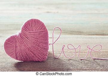 rosa, forma corazón, clew
