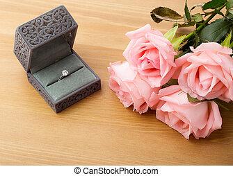 rosa subió, anillo, compromiso