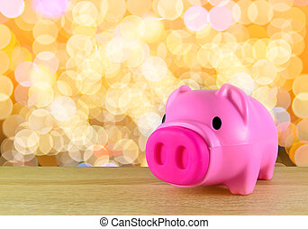 rosafarbene piggy bank, auf, holztisch, mit, bunte, verwischt, bokeh, hintergrund