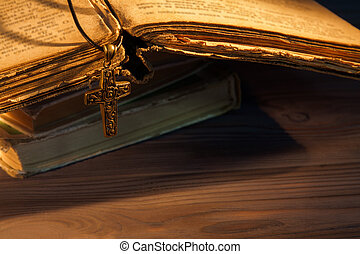 Rosary and cross on the old ancient bible.