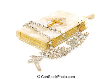 Rosary and First Communion book isolated on white background...