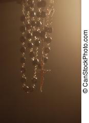 Rosary Backlighting in Mystical Atmosphere