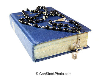 Rosary beads and Bible