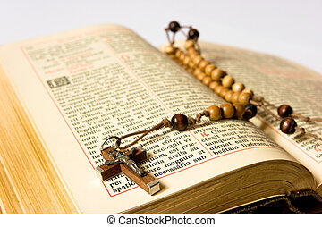 Rosary beads and breviary - The book of Catholic Church...