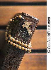 Rosary beads and holy bible.
