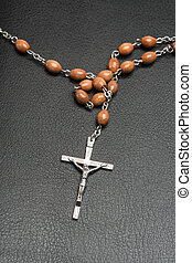 Rosary beads on a bible - Rosary beads on a black leather...