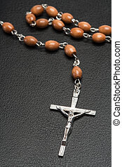 Rosary beads resting on a bible - Rosary beads resting on a...