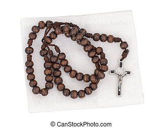 Rosary isolated with pouch on white background. Christian cross, crucifix, wooden beads.