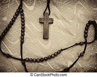sepia toned rosary with vignette, high contrast image, useful for various religious themes