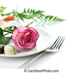 rose and candy on a plate