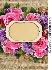 Rose and chrysanthemum flowers with card on canvas