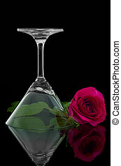 Rose and overturn empty cocktail glass