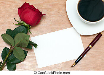 Rose and sheet of paper