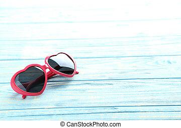 rose, bois, bleu, lunettes soleil, table