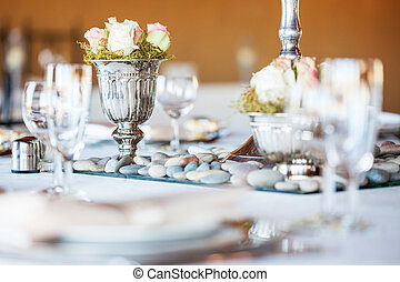 Rose bouquet in silver vase at wedding reception