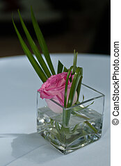 Singe pink rose as table centerpiece