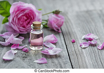 Rose essential oil - Glass vial with rose essential oil and...