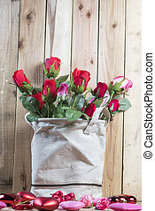 rose flower on wooden wall background