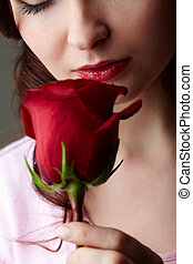 Rose fragrance - Close-up of attractive woman holding red ...