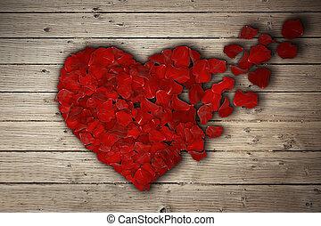 rose heart 3 - Red rose petals arranged in shape of a broken...