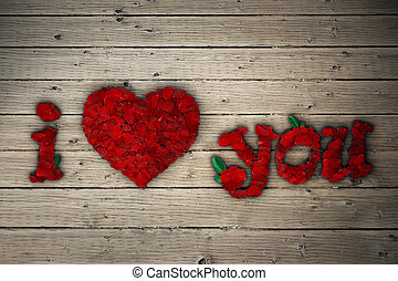 rose heart - I Love You message of red rose petals on wooden...