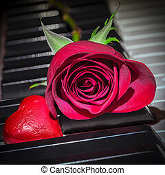 rose heart - red rose and heart on piano