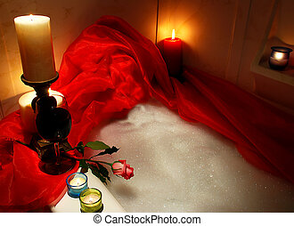 rose in bathtub - bathtube surrounded with candles, glass of...