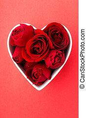 Rose inside the heart shape bowl