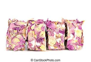 Rose locum - Arabic rose locum with nuts and dry rose, close...