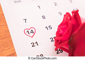 rose on the calendar with the date of February 14 Valentine's day
