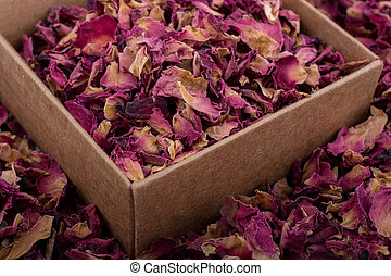 Rose petals in box and as a background