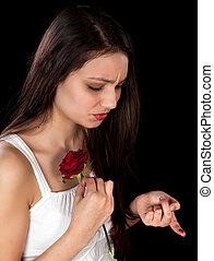 Rose pricking a finger