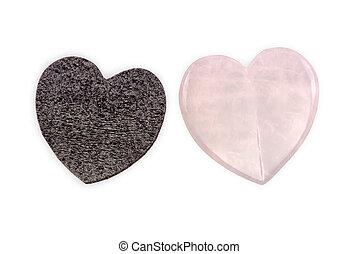 Rose quartz heart and black foam heart isolated on white ...