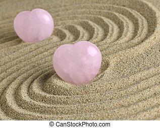 Rose Quartz heart in zen garden - Rose quartz hearts placed ...