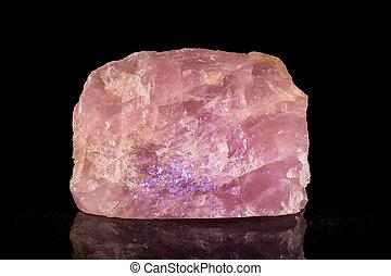 rose quartz in front of black - rose quartz birthstone in...