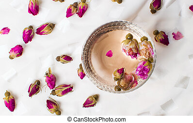 Rose tea in a cup on white