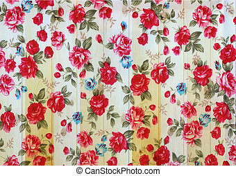 Rose vintage from fabric on white wooden background.