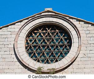 Rose window. St. Francesco Church. Corciano. Umbria.