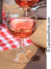 Rose wine - Glass of rose wine on a table