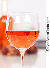 Rose wine in a glass portrait format bottle alcohol