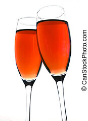 Rose Wine Toast - Rose wine in flutes during toast