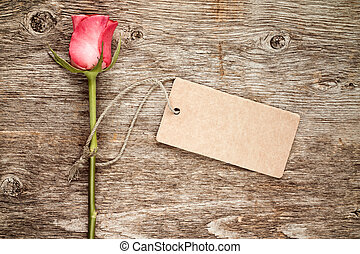 Rose with blank tag tied with string