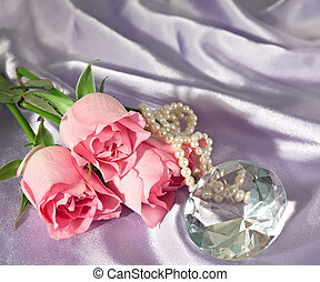 Rosebuds and diamond and pearls - Three pink rosebuds with ...