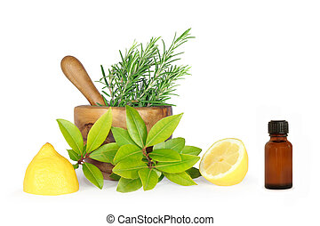 Rosemary and bay herb leaf selection with half a lemon, olive wood pestle and mortar and brown glass aromatherapy bottle. Over white background.