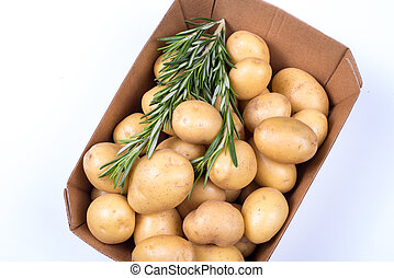 Rosemary and Potatoes in a box on isolated white background