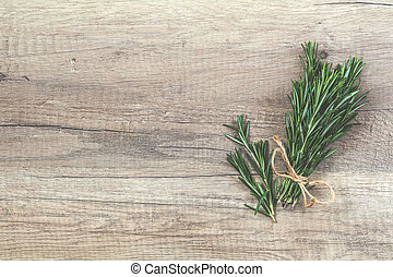 Rosemary bunch of bouquets on light wooden surface. Top...