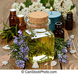 Rosemary essential oil on brown background