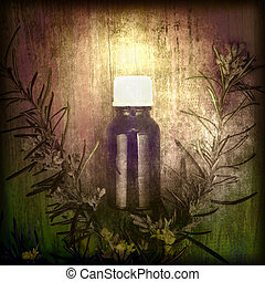 Rosemary essential oil on wood background and grunge texture
