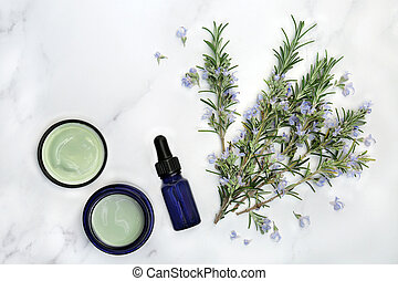 Vegan skin care beauty treatment with rosemary herb flowers, aromatherapy essential oil & moisturiser on marble. Anti ageing benefits & helps to reduce environmental skin damage. Flat lay.